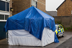 A police tent covers the spot where a woman in her 20s was found injured outside the Brookbank Tower in Enfield, North London, and declared dead at the scene. According to a local resident the woman had fallen from a top floor flat in the tower black. A man was arrested nearby on suspicion of murder. . London, April 08 2019.