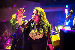 """© Licensed to London News Pictures . 05/02/2016 . Manchester , UK . ROWETTA IDAH . """" Hacienda Classical """" debut at the Bridgewater Hall . The 70 piece Manchester Camerata and performers including New Order's Peter Hook , Shaun Ryder , Rowetta Idah , Bez and Hacienda DJs Graeme Park and Mike Pickering mixing live compositions . Photo credit : Joel Goodman/LNP"""