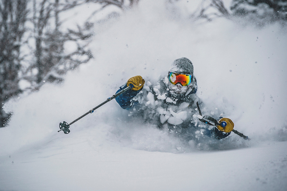 A late Jaunuary storm brings much needed snow to the Wasatch Mountains. Mike Quigley soaks it up in the Brighton backcountry, Utah.