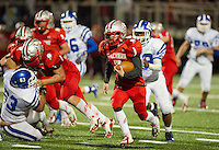 Laconia's  Cody Greenwood charges down field  to score during Friday night's Homecoming game against Manchester West.  (Karen Bobotas/for the Laconia Daily Sun)