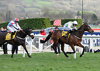 National Hunt Horse Racing - 2019 Cheltenham Festival - Thursday, Day Three (St Patrick's Day)<br /> <br /> P Townend on Min runs for the line after the last fence, ahead of Gavin Sheehan on Saint Calvados in the 14.50 Ryan Air Steeple Chase (Grade 1, Class 1), at Cheltenham Racecourse.<br /> <br /> COLORSPORT/ANDREW COWIE