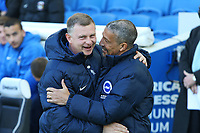 Football - 2017 / 2018 FA Cup - Fifth Round : Brighton and Hove Albion vs. Coventry City<br /> <br /> Brighton Manager Chris Hughton shares a laugh before kick off with Coventry City Manager Mark Robins at The Amex Stadium Brighton <br /> <br /> COLORSPORT/SHAUN BOGGUST