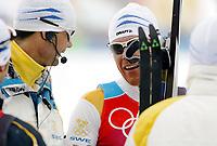 OL 2006 Langrenn menn stafett,<br />Pragelato Plan<br />19..02.06 <br />Foto: Sigbjørn Hofsmo, Digitalsport <br /><br />Mathias Fredriksson SWE - Sverige Thomas Alsgaard trener sverige