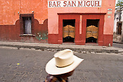 05 APRIL 2004 - SAN MIGUEL DE ALLENDE, GUANAJUATO, MEXICO: A man walks past the Bar San Miguel, a popular cantina in San Miguel de Allende. San Miguel, which was founded in the 1600s, is one of Mexico's premier colonial cities. It has very strict zoning and building codes meant to preserve the historic nature of the city center. About 7,500 US citizens, mostly retirees, live in San Miguel. PHOTO BY JACK KURTZ
