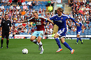 Scott Arfield of Burnley looks to get away from Philipp Hofmann of Brentford.  Skybet football league championship match, Burnley  v Brentford at Turf Moor in Burnley, Lancs on Saturday 22nd August 2015.<br /> pic by Chris Stading, Andrew Orchard sports photography.