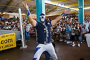 July 13, 2008 -- PHOENIX, AZ: Mr. Galaxy, a tecnico luchador (good guy wrestler) fires up the crowd before a Lucha Libre show at El Gran Mercado in Phoenix. Lucha Libre is Mexican style wrestling. There are heros (Tecnicos) and villians (Rudos). The masks are popular as children's gifts and tourist mementos. As the size of the Mexican community in the Phoenix area has grown, attendance at the Lucha Libre shows has increased. Lucha Libre differs from American style entertainment wrestling in several ways, but principally the wrestlers are more acrobatic and rely less on body slams than American wrestling. The shows, which used to be held only periodically, are now held every week at El Gran Mercado, a flea market and swap meet that caters mostly to the Mexican community in Phoenix.   Photo by Jack Kurtz / ZUMA Press