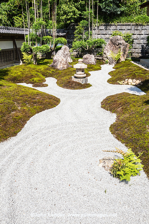 Zen Garden at Hase-dera - Hase-dera officially named Kaiko-zan Jisho-in Hase-dera but commonly called Hase Kannon.  Hase-Dera has landscaped Japanese gardens, a giant prayer wheel, jizo caves, a bamboo grove, and a vegetarian restaurant up the hill with a bird-eye view of Kamakura and the Shonan Coast. Hase-dera is famous for its massive wooden statue of Kannon - a treasure of Japan.  Originally belonging to the Tendai sect of Buddhism, Hase-dera became an independent temple of the Jodo sect of Zen Buddhism.