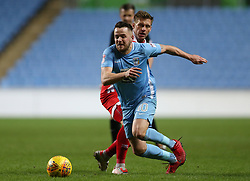Coventry City's Marc McNulty and Crawley Town's Danne Bulman