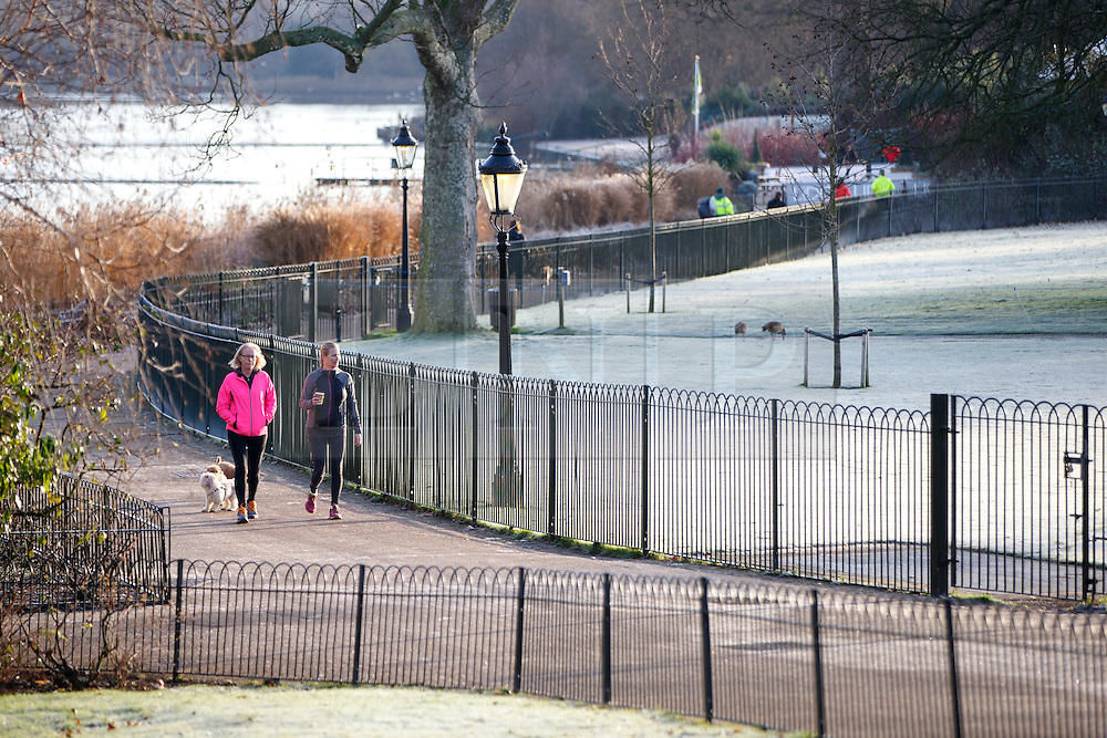 © Licensed to London News Pictures. 03/01/2017. London, UK. People walk their dogs in Hyde Park, London on a frosty morning as temperatures in the capital drop below zero celsius on Tuesday, 3 January 2017. Photo credit: Tolga Akmen/LNP