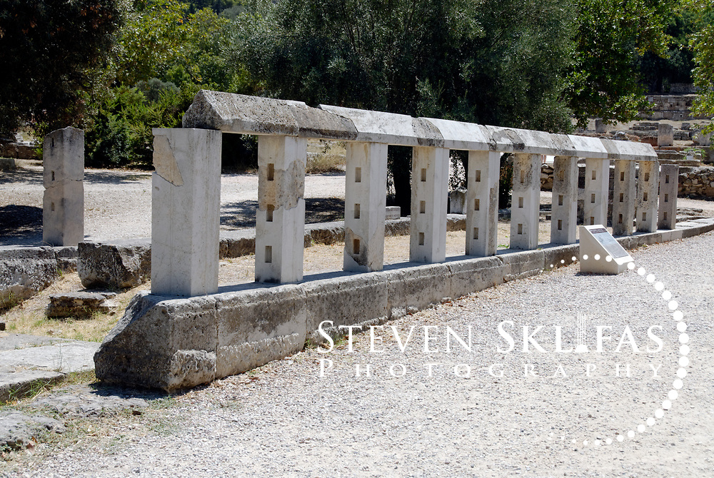 View of the 4th century BC monument of the Eponymous Heroes in the Agora. On the 16 metre long narrow base once stood ten bronze statues of legendary heroes chosen by the Delphic Oracle as founders of the ten tribes of Attica. New laws and official announcements were made public here in ancient times. The Agora from 600 BC onwards was the commercial and social centre of Ancient Athens. It was here that laws were written and displayed, commercial goods bought and sold, intellectual discussions were had, and the democratic spirited was born and nurtured.