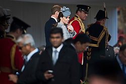 © London News Pictures. 21/10/2014.   Catherine Duchess of Cambridge and Prince William accompany HRH Queen Elizabeth II (NOT PICTURED) as she Greets the President of the Republic of Singapore,  Tony Tan Keng Yam and his wife Mary Chee Bee Kiang on Horseguards Parade in London as part of a Ceremonial welcome for the Singapore state visit.  Photo credit : Ben Cawthra/LNP
