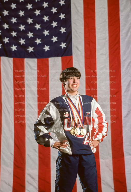 COLORADO SPRINGS, CO -  NOVEMBER 1988:  Janet Evans of the USA poses with the three Olympic gold medals she won at the 1988 Summer Olympic Games during a portrait session in November 1988 at the US Olympic Training Center in Colorado Springs, Colorado.   (Photo by David Madison/Getty Images) *** Local Caption *** Janet Evans