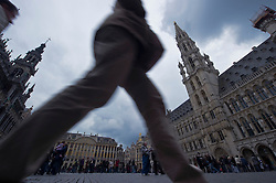 Tourists visit the Grand Place, the historic main square in the center of Brussels, Belgium. (Photo © Jock Fistick)