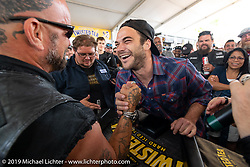 Photographer Preston Burroughs shows off his secret talent at Dirty Harry's arm wrestling competition on Main Street during Daytona Beach Bike Week, FL. USA. Saturday, March 16, 2019. Photography ©2019 Michael Lichter.