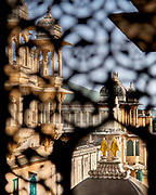 Elaborate stone carved windows area a feature of the City Palace in Udaipur, Rajasthan, India <br /> <br /> Editorial & Non-Commercial use only