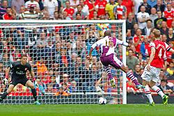 Aston Villa's Fabian Delph takes a shot at goal  - Photo mandatory by-line: Mitch Gunn/JMP - Tel: Mobile: 07966 386802 17/08/2013 - SPORT - FOOTBALL - Emirates Stadium - London -  Arsenal V Aston Villa - Barclays Premier League