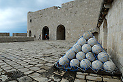 Paved courtyard with stack of pseudo-cannonballs. Fortress Lovrinjenac (Fort of Saint Lawrence), Dubrovnik old town, Croatia
