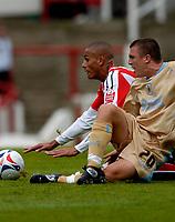 Photo: Catrine Gapper.<br /> Brentford v Bristol City. Coca Cola League 1.<br /> 24/09/2005.<br /> Darren Pratley and Sam Brown following Prately's dangerous tackle.