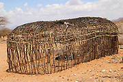 Traditional Maasai (Masai) hut is constructed from applying mud to a lattice framework of reeds Photographed in Kenya