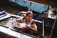 A woman selling Hu Tieu noodles from her boat at the Cai Rang floating market in the Mekong Delta in southern Vietnam.