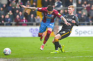 Adam Hammill of Scunthorpe United (47) and Lewis O'Brien of Bradford City (39) during the EFL Sky Bet League 1 match between Scunthorpe United and Bradford City at Glanford Park, Scunthorpe, England on 27 April 2019.
