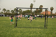 Israel, Tel Aviv, Ganei Yehoshua park, children playing soccer during the football for peace tournament aimed at closing the gap between Arab and Jewish children