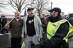 © Licensed to London News Pictures . 20/01/2018. Doncaster, UK. EDL supporters shout at anti-fascist counter protesters and members of the local community . Far-right street protest movement , the English Defence League ( EDL ) march through Hexthorpe after holding a demonstration , opposed by anti-fascists , including Unite Against Fascism ( UAF ) in the Hexthorpe area of Doncaster . EDL supporters chanted anti-Roma slogans as they marched through the town . Photo credit: Joel Goodman/LNP