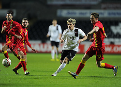 Christoph Leitgeb (Red Bull Salzburg) of Austria  battles for the ball with Joe Allen (Liverpool) of Wales and Andy King (Leicester City) of Wales  - Photo mandatory by-line: Joe Meredith/JMP - Tel: Mobile: 07966 386802 06/02/2013 - SPORT - FOOTBALL - Liberty Stadium - Swansea  -  Wales V Austria - International Friendly