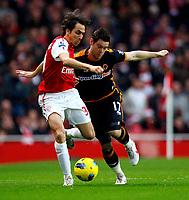 20111227: LONDON, UK - Barclays Premier League 2011/2012: Arsenal vS Wolverhampton Wanderers.<br /> In photo: Yossi Benayoun of Arsenal holds off Matthew Jarvis of Wolverhampton Wanderers.<br /> PHOTO: CITYFILES