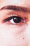 eye close up with halftone print dots