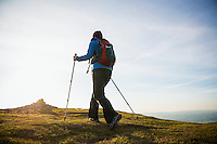 Female hiker on summit of Twmpa, Black Mountains, Brecon Beacons national park, Wales