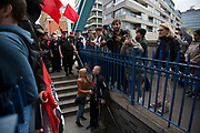 Anarchists gather as a black bloc for the Fuck Parade to party and protest at the class and wealth divide between rich and poor and the gentrification of London, the demonstration was organised by anarchist group Class War on May 1st 2016 in London, United Kingdom. The parade is now part of the May Day activism calendar as dissatisfaction about the establishment, the police and the inadequacy of the press is highlighted. A passer by becomes agressive with the protesters and they turn on him. Blocked by police he is convinced to turn away by his friend. (photo by Mike Kemp/In Pictures via Getty Images)
