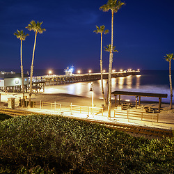 San Clemente California pier at night high resolution photo. In the foreground is the San Clemente Pedestrian Beach trail and train tracks. San Clemente California is a popular beach city along the Pacific Ocean n the United States of America. Copyright ⓒ 2017 Paul Velgos with All Rights Reserved.