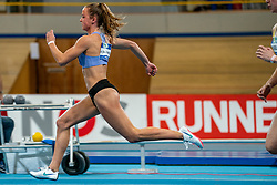 Anne van de Wiel in action on the 60 meter hurdles during AA Drink Dutch Athletics Championship Indoor on 21 February 2021 in Apeldoorn.