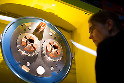© licensed to London News Pictures. London, UK 12/11/2013. Spectators interacting with the Collider exhibition at Science Museum in London, which offers a behind the scenes look at the CERN particle physics laboratory in Geneva and touches on the discovery of the 'God particle' theory of Peter Higgs. Photo credit: Tolga Akmen/LNP