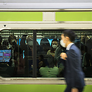 Crowded train at a Tokyo subway station.