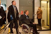 25 JAN 2000, BERLIN/GERMANY:<br /> Wolfgang Schäuble, CDU, CDU/CSU Fraktionsvorsitzender, meidet die Mikofone auf dem Weg zur CDU/CSU Fraktionssitzung, Deutscher Bundestag, Reichstag<br /> IMAGE: 20000125-02/01-20<br /> KEYWORDS: Wolfgang Schaeuble, Rollstuhl, wheel chair,