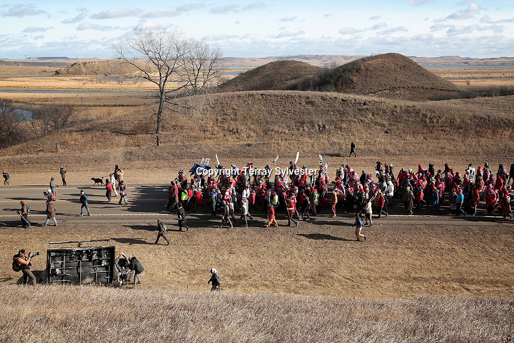 Opponents of the Dakota Access oil pipeline march toward the pipeline route and a tributary of the Missouri River on November 18, 2016. Cannon Ball, North Dakota, United States.