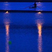Rowers training on the water at dawn on Lake Karapiro, near Cambridge, Waikato. Many national and international rowing competitions are held on Lake Karapiro which is also the home of The Rowing New Zealand High Performance Centre. Lake Karapiro hosted the 2010 World Rowing Championships. Lake Karapiro, Waikato,  New Zealand. 13th December 2010. Photo Tim Clayton.