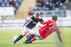 Falkirk's Craig Sibbald tackles Brechin City's Paul McLean. <br /> Falkirk 2 v 1 Brechin City, Scottish Cup fifth round game played today at The Falkirk Stadium.