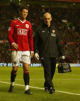 Photo: Aidan Ellis.<br /> Manchester United v Chelsea. The Barclays Premiership. 26/11/2006.<br /> United's Cristiano Ronaldo leaves the pitch injured after a challenge from Ashley Cole