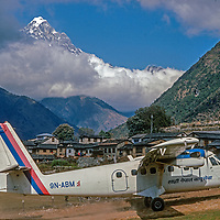 A Twin-Otter STOL bush plane lands at Lukla airstrip, the gateway to  Mount Everst and the Khumbu region, Nepal.
