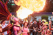 Gordon Tsai, businessman and founder / organizer of the Dream Parade breathes fire.