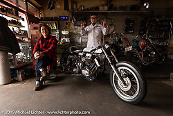 Ken Kentaro in his Hot Chop Speed Shop with his  twin-engine Harley-Davidson Sportster drag bike and his friend, mechanic Kazuhiro Takahashi who helped build the engines. (Both will pilot the bike on the drag strip.) Kyoto, Japan. Friday, December 7, 2018. Photography ©2018 Michael Lichter.