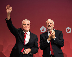 © Licensed to London News Pictures . 25/09/2017. Brighton, UK. Shadow chancellor JOHN MCDONNELL and JEREMY CORBYN stand together after McDonnell's speech at The Labour Party Conference at The Brighton Centre . Photo credit: Joel Goodman/LNP