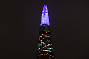 The top spire of the Shard is illuminated in blue on December 4th 2017 in London, United Kingdom, on the first evening of the Shards festive Christmas light show. Every evening, counting down to the start of 2018, the Shard will illuminate the London skyline from dusk till dawn, with Western Europe's highest light show each evening during December.