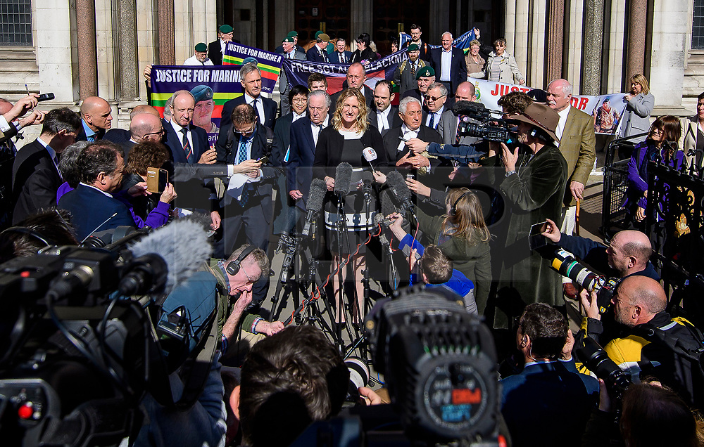 © Licensed to London News Pictures.15/03/2017.London, UK.  CLAIRE BLACKMAN (C), wife of Sergeant Alexander Blackman, reading a statement to the media as she leaves the Royal Courts of Justice in London, where a judge reduced the conviction of Sgt Blackman from Murder to Manslaughter, on appeal.  Also known as Marine A, Sgt Blackman was appealing a life sentence for the murder of a wounded Taliban fighter in Afghanistan in 2011.Photo credit: Ben Cawthra/LNP