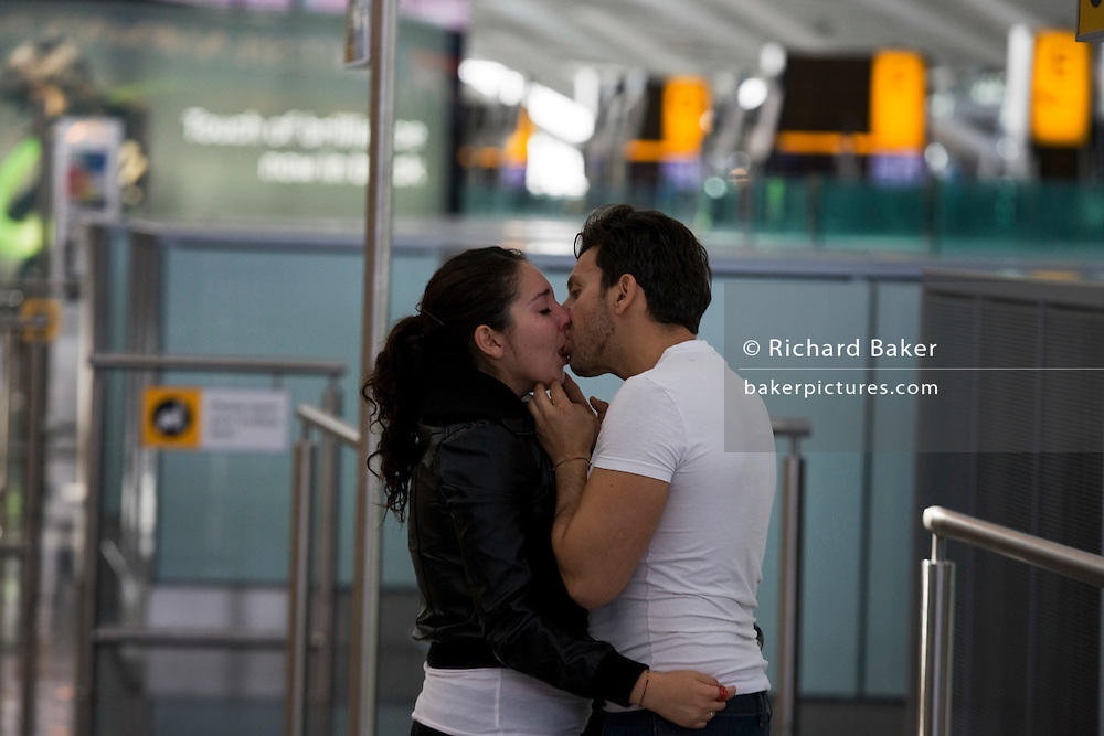 Departing lovers say their emotional farewells in Departures at Heathrow Airport's Terminal 5.