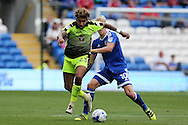 Danny Williams of Reading breaks away from Lex Immers of Cardiff city ®. EFL Skybet championship match, Cardiff city v Reading at the Cardiff city stadium in Cardiff, South Wales on Saturday 27th August 2016.<br /> pic by Andrew Orchard, Andrew Orchard sports photography.
