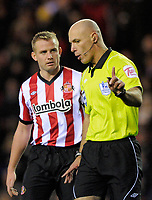 20111226: LONDON, UK - Barclays Premier League 2011/2012: Sunderland vs Everton.<br /> In photo: Lee Cattermole of Sunderland AFC protests to referee Howard Webb over his penalty decision.<br /> PHOTO: CITYFILES